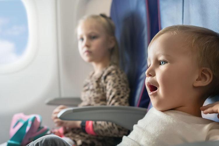 Portrait of cute boy in airplane