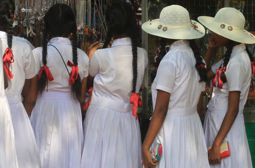 Coin Purse Hair Braids Hats Lifestyles Medium Group Of People Polonnaruwa Red Ribbon School Uniforms Around The World Schoolgirls Side By Side Sri Lanka Standing Togetherness White Clothes The Street Photographer - 2016 EyeEm Awards