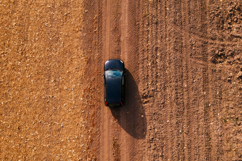 Aerial view of black car on dirt road through countryside, top view driving vehicle from drone pov Aerial View Aerial Photography Car Black Color Dirt Road Countryside Driving Vehicle Interior Drone  Drone Photography Drone Pov Nature Transportation Transport Top View From Above  Autumn Outdoors SUV Off-road Vehicle Off-Road Dust Dusty Road Travel Country Road
