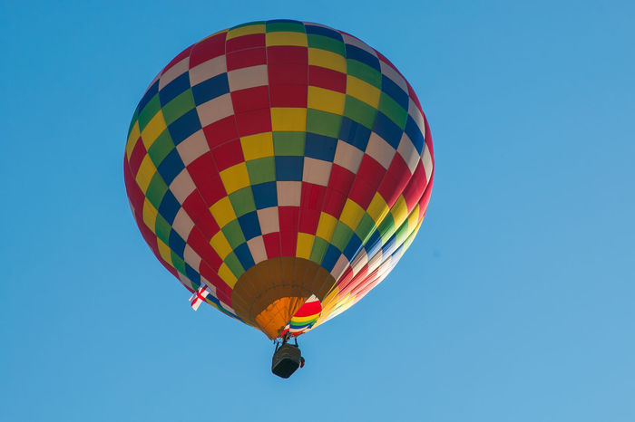 Photo of colored hot air balloon Colored Transport Transportation Adventure Air Vehicle Balloon Ballooning Festival Blue Clear Sky Copy Space Extreme Sports Festival Flying Freedom Hot Air Balloon Low Angle View Mid-air Multi Colored Nature Outdoors Pattern Sky Sport Transportation