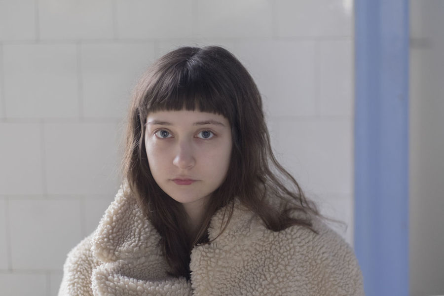 Portrait of a young female model in fake fur coat in the bathroom Beautiful BlueIsTheWarmestColour Dream Dreaming Fairytale  Fine Art Photography Looking At Camera Bathroom Beautiful Woman Blue Boat Boats Dreamy Drepression Eyes Eyesight Fine Art Girl Melancholy Misterious Moody Portrait Sad Sadness Young Adult