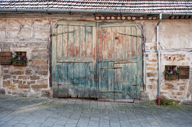 Architecture Building Exterior Built Structure Old Building No People Day Door Entrance House Closed Footpath City Wall Residential District Weathered Outdoors Wall - Building Feature Street Safety Barndoor