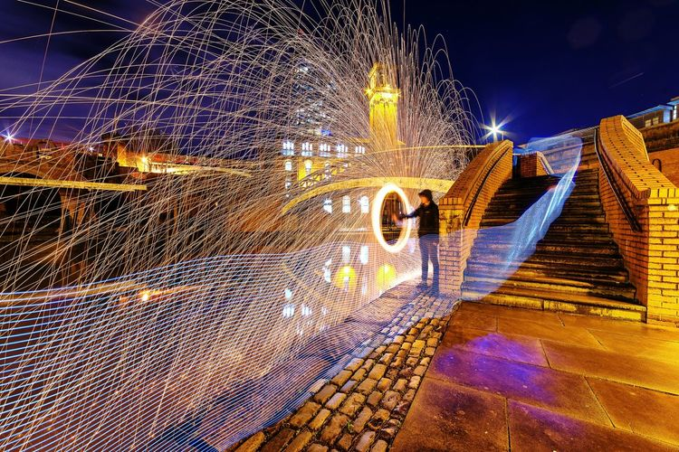 Man Spinning Illuminated Wire Wool At Night