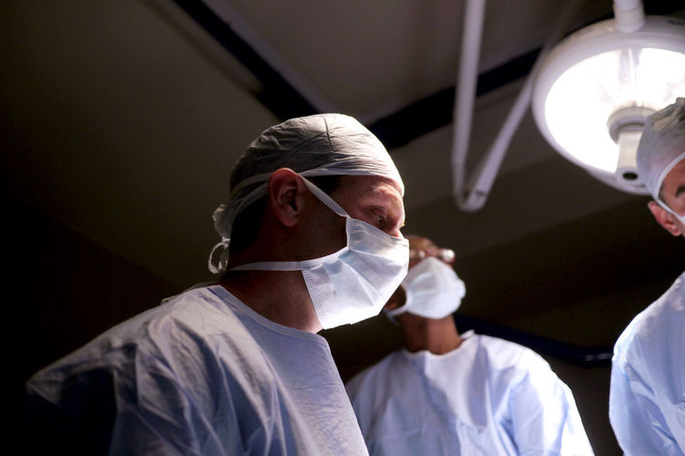 Close-up of doctors in operating room