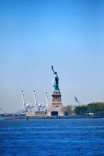 Statue of liberty Statue Of Liberty No People New York City New York City Travel Photography Street Photography Travel Destinations Statue Sea Sea Statue Waterfront Human Representation Water Clear Sky Copy Space Statue Of Liberty Blue Commercial Dock Outdoors No People Harbor Ocean New York City Tranquility