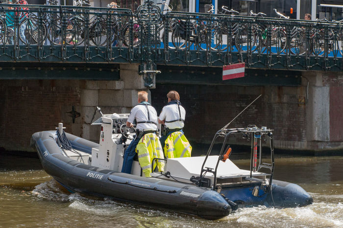 Police boat canal Amsterdam Action Boat Bridge Canal Netherlands Police Policeboat Summer Summertime Your Amsterdam People