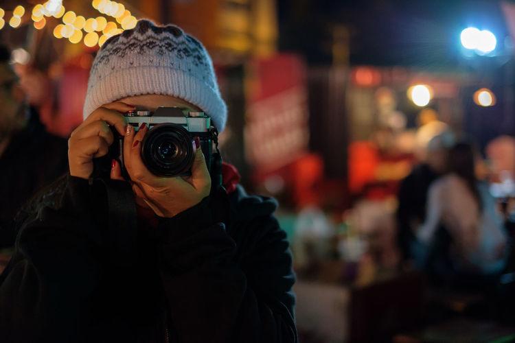 Close-up portrait of child holding camera