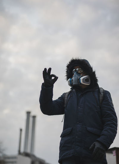 Portrait of man with mask photographing against sky during ok after corona outbrake in berlin 2020