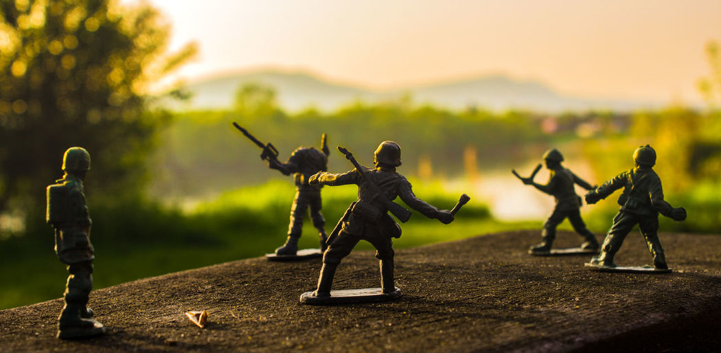 Close-up of toy soldiers on retaining wall