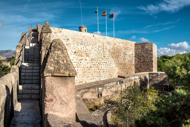 Gibralfaro castle (Alcazaba de Malaga), Spain Ancient Architecture Andalucía Architecture Blue Sky Building Exterior Built Structure Castle Costa Del Sol Defense Architecture Europe Flags Fortification Fortress Gibralfaro Gibralfaro, Malaga History Insignia Landscape Malaga National Landmark No People Nobody Outdoors SPAIN Wartime Architecture
