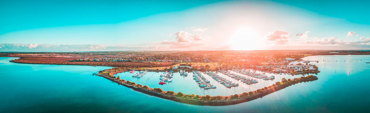 Aerial panorama of coastline and moored boats at sunset. Hastings, Victoria, Australia Australia Australian Australian Landscape Coastline Coastline Landscape Drone  Marina Panorama Panoramic Aerial Aerial View Architecture Beauty In Nature Boats Breakwater City Cityscape Dawn Day Drone Photography Dusk Melbourne Nature Nautical Vessel No People Outdoors Scenics Sea Sky Skyscraper Sunlight Sunrise Sunset Swimming Pool Travel Destinations Vacations Water Waterfront Westernport