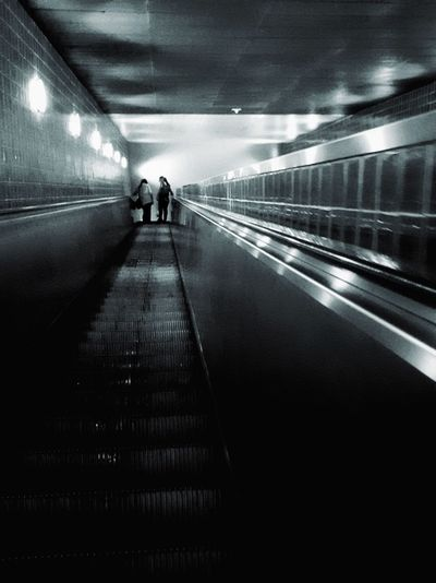 People on escalator at subway station