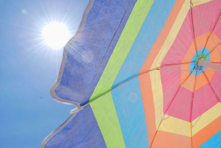 Low angle view of umbrella on sunny day