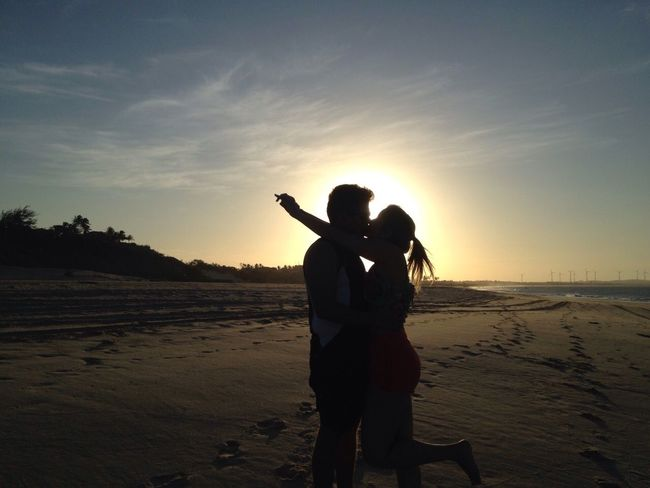 Love over the Sunset Beach Beauty In Nature Day Nature Sand Sea Sky Standing Sunset Two People Water