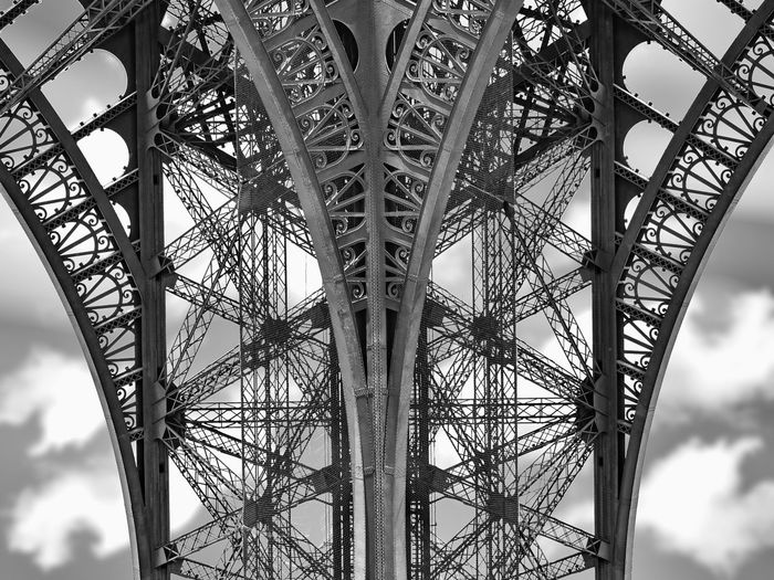 Take a closer look at the Eiffel Tower Toureiffel Eiffel Tower Tour Eiffel Paris Paris, France  Paris ❤ Blackandwhite Black And White Black & White France Cloud - Sky Architecture Clouds And Sky Old Town Dramatic Sky Tree Complexity Pattern Sky Architecture Close-up Built Structure Office Building Historic Full Frame Tower Architectural Detail Communications Tower Textured  Skyscraper