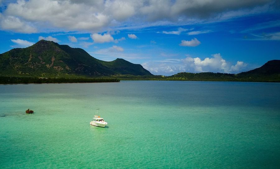 Mountain Scenics Water Beauty In Nature Tranquility Tranquil Scene Nature Sky Nautical Vessel Cloud - Sky Outdoors Day Transportation Sea Mountain Range No People Travel Destinations Sailing DJI Mavic Pro Aerial View Aerial Photography Dronestagram Mauritius Ilemaurice The Great Outdoors - 2017 EyeEm Awards Scenics - Nature Transportation Beauty In Nature Idyllic Travel
