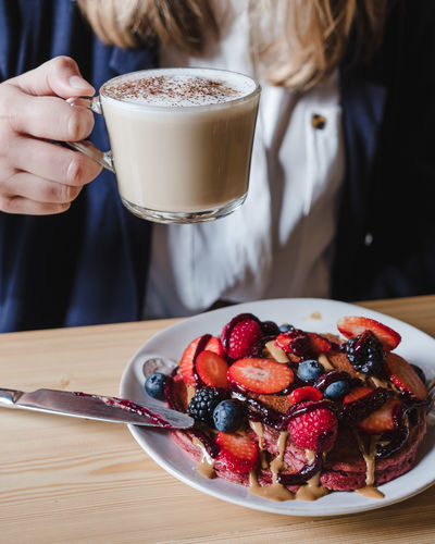 Food And Drink Food Freshness Berry Fruit Coffee Table Fruit Sweet Food Cup Indoors  Focus On Foreground Coffee - Drink Drink Real People Dessert One Person Midsection Mug Holding Coffee Cup Hand Temptation