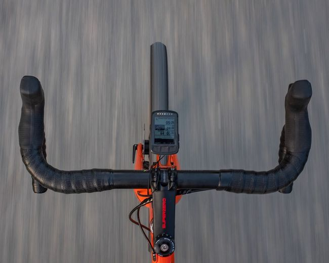 Close-up of bicycle on street against wall