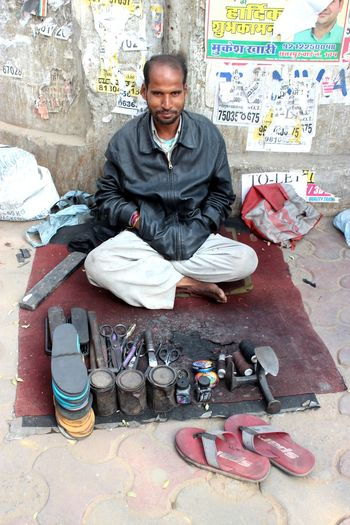 A shoemaker in New Delhi, India in December 2016 Work Streets India New Delhi Job Humans Of India One Person Sitting Looking At Camera Men Full Length Portrait Front View Adult Real People Business Outdoors Lifestyles Occupation