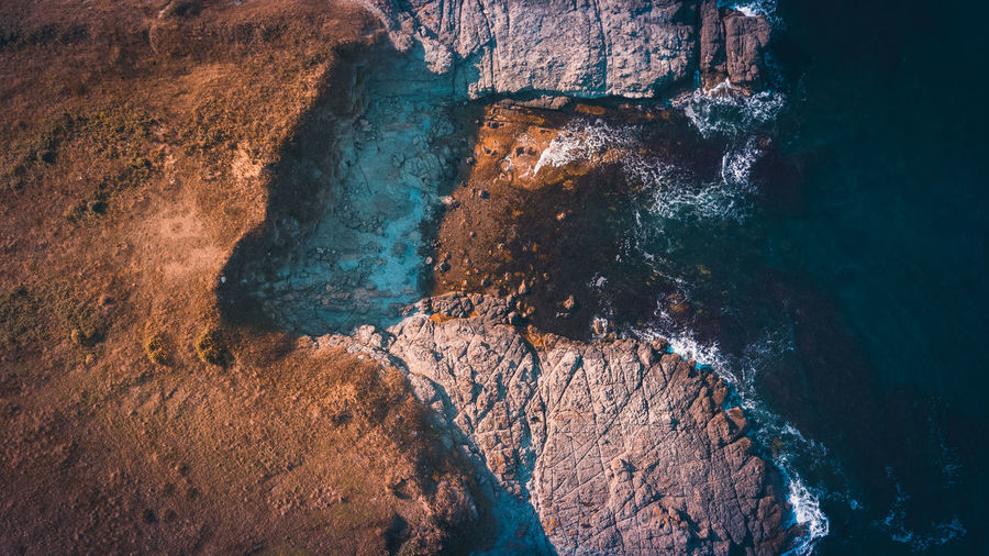 Aerial view of rock formations and sea