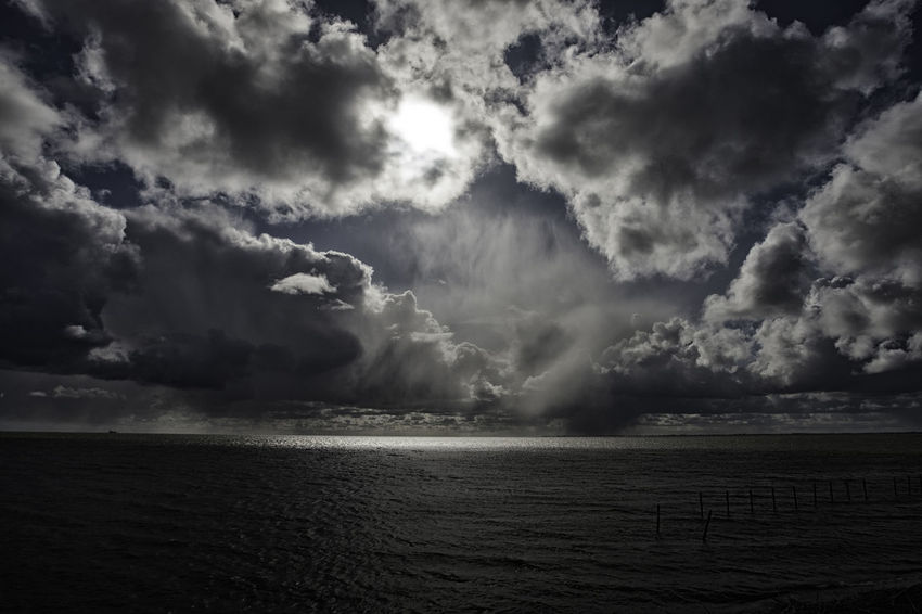 Rainy clouds covering the sun on a rainy day in the afternoon Beauty In Nature Calm Cloud Cloud - Sky Cloudy Coastline Day Horizon Over Water Idyllic Nature No People Non-urban Scene Ocean Outdoors Rippled Scenics Sea Seascape Sky Tranquil Scene Tranquility Water Weather Dramatic Sky Lightfall