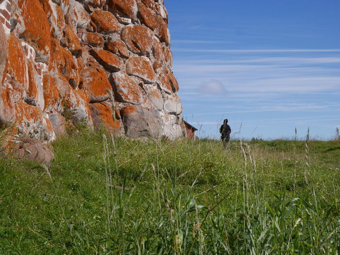 Grass Plant Land Sky Nature Men Field Beauty In Nature Real People Day Growth Lifestyles People Activity Non-urban Scene Two People Tranquility Outdoors Tower Stone Wall Church Russia Solovetskie Ostrova Solovki