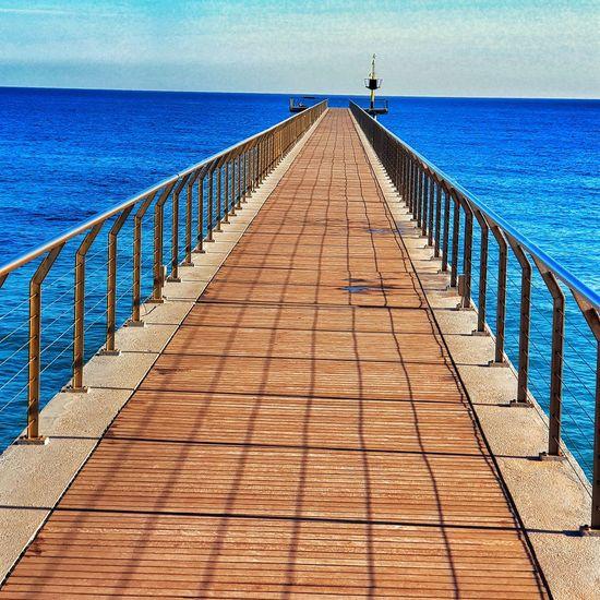 Sea Beach Clear Sky Wood Paneling Shadow Sunlight Blue Railing Sky Ocean