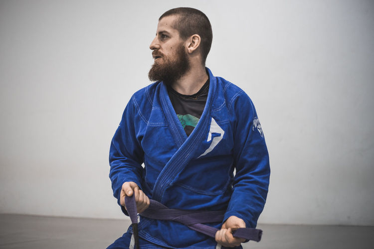 Brazilian Jiu Jitsu Martial Arts Belt  Bjj Day Fighter Front View Indoors  Leisure Activity One Person People Real People Sitting White Background Young Adult Young Men This Is Masculinity Modern Workplace Culture