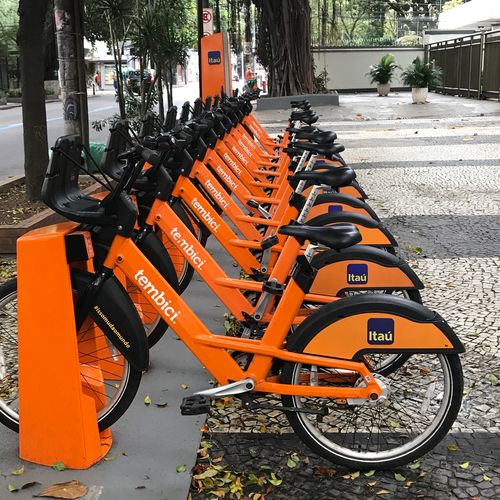 Bikes 2 Transportation Land Vehicle Mode Of Transportation Orange Color Day In A Row City Bicycle Parking
