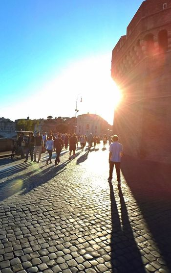 Magical sun in magical Rome Architecture Street Sunset Walk Walking People Rome Rome, Italy Travel Destinations Travel Traveling Summertime Streetphotography Men Full Length City Clear Sky Sunset Sunlight Shadow Walking Lens Flare Sun Street Scene Tourism Sunbeam Shining Visiting Cobblestone Building