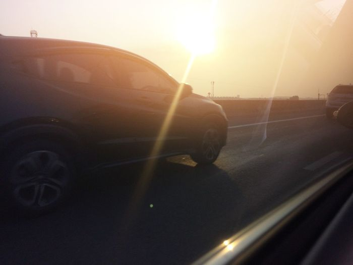 Car parked on street, Car parked on road,Car driving on highway road High Way Black Car Car Transportation Lens Flare Land Vehicle Sun Road Mode Of Transport Sunlight Outdoors Sunbeam Close-up No People Sky Day Sunset