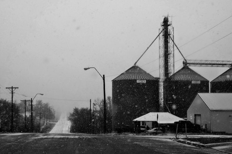 Visual Journal December 3, 2016 Western, Nebraska (Fujifilm Xt1,Canon FD 50mm f/1.8 ) edited with Google Photos. A Day In The Life B&W Collection B&w Photography Built Structure Camera Work Everyday Lives Eye For Photography EyeEm Best Shots Farm Life First Snow FUJIFILM X-T1 Grain Silos Manual Focus Manual Mode Photography Nifty Fifty No People Outdoors Photo Diary Photography Rural America Rural Life Small Town Small Town Stories Visual Journal Winter