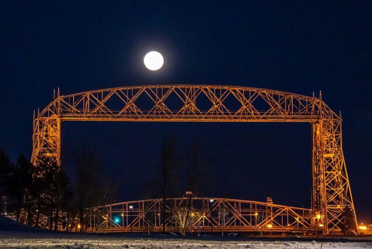 Moon over Lift Bridge Moon Malephotographerofthemonth Night Illuminated Sky Architecture Built Structure Nature Bridge Outdoors Bridge - Man Made Structure Full Moon Clear Sky