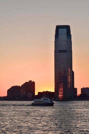 Hudson River Battery Park Pink Sky Architecture Building Exterior Built Structure Sky Sunset City Modern Water Office Building Exterior Skyscraper Sea Tall - High Building No People Cityscape Tower Travel Destinations Orange Color Waterfront Nature