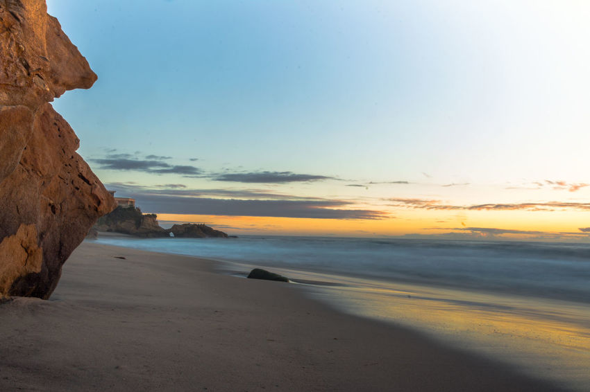 Arid Climate Beach Cloud Coastline Geology Horizon Over Water Outdoors Physical Geography Sand Scenics Sea Shore Silhouette Sky Sunset Tranquil Scene Tranquility Traveling Vacations Voyage