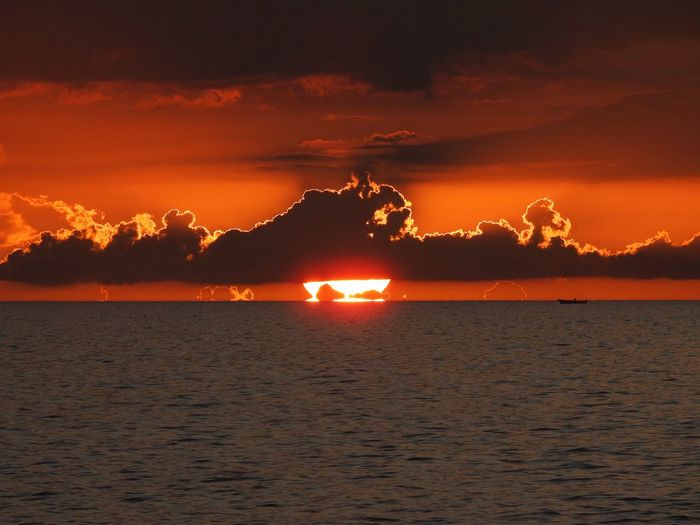 Sun reflection Water Sky Sunset Beauty In Nature Sea Cloud - Sky Scenics - Nature Orange Color Nature Tranquility Tranquil Scene No People Beach Idyllic Illuminated Land Outdoors Waterfront Mountain