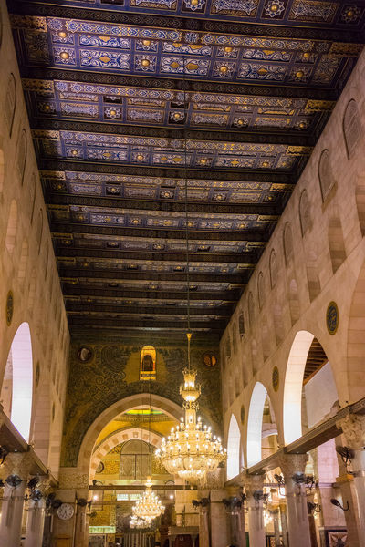 """BAITULMUQADDIS, PALESTINE - 13TH NOV 2017; Internal view of Al-Aqsa Mosque, Jerusalem. Built in 691, where Prophet Mohamed ascended to heaven on an angel in his """"night journey"""". Al-Aqsa Mosque Architecture Caligraphy Classic Faith Peace And Quiet Pray Prosperity Tourist Attraction  Tradition Wood Arabic Chendelier Culture Dome Heritage Building Holy Place Islam Jerusalem Mosque Muslim Old Tourism Travel Destinations Vintage"""