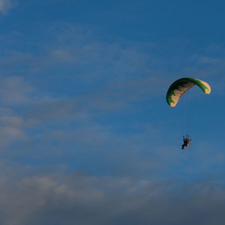 Paraglider in the morning sun crosses our way. Activity Adventure Extreme Sports Flying Gliding Leisure Activity Lifestyles Mid-air Outdoors Parachute Paragliding People RISK Sky Skydiving Sport Transportation Unrecognizable Person
