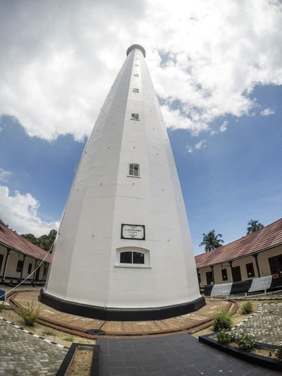 History Religion Architecture Travel Destinations Sky Cloud - Sky Day Built Structure Outdoors Pyramid No People Building Exterior Politics And Government City Lighthouse Pulau Lengkuas Belitung Island INDONESIA