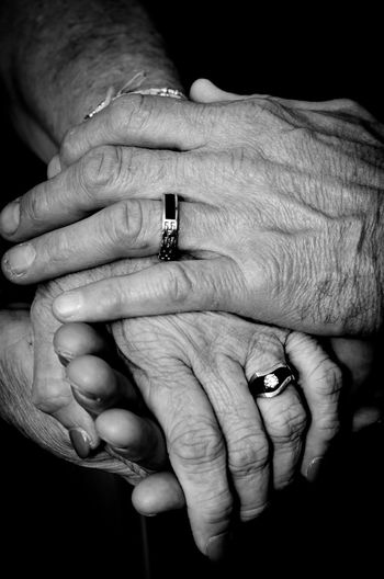 Human Hand Hand Human Body Part Ring Finger Human Finger Jewelry Body Part Adult Two People Love Indoors  Women Togetherness People Bonding Men Positive Emotion Real People Senior Adult Couple - Relationship Care Black Background