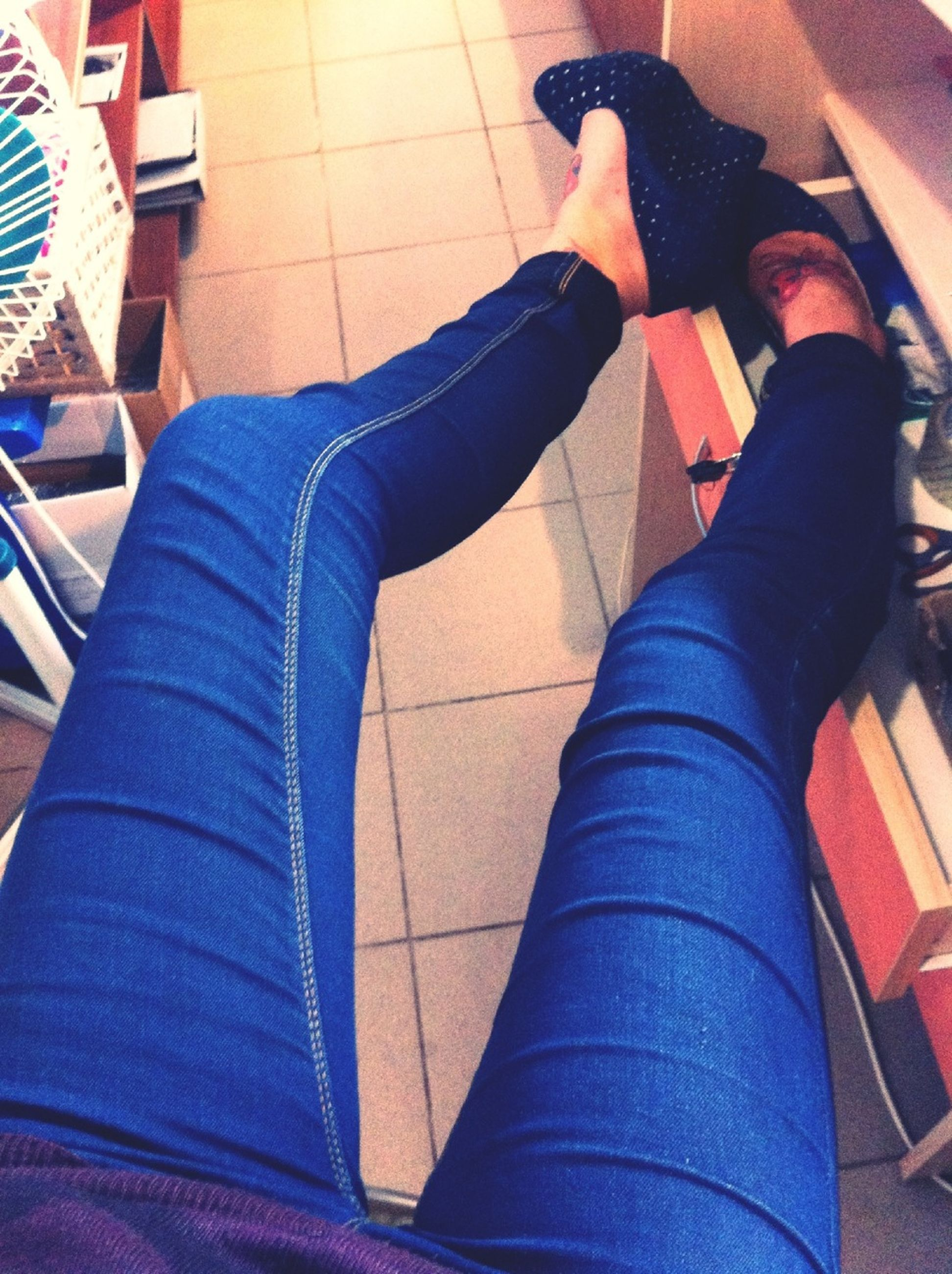 low section, person, shoe, jeans, indoors, lifestyles, men, blue, standing, casual clothing, high angle view, human foot, leisure activity, personal perspective, footwear, sitting