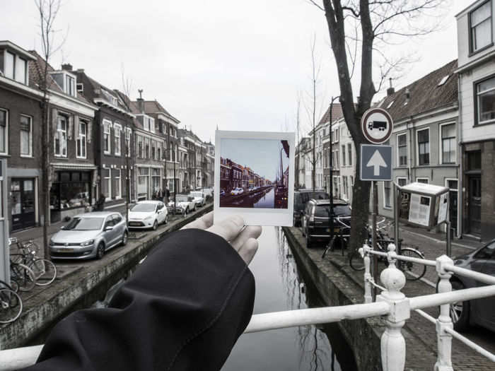 Architecture Building Exterior Built Structure Transportation Mode Of Transportation Sky Water Building City Nature Day Street Railing Outdoors Nautical Vessel One Person Residential District Car Incidental People Canal Instant Camera Instantphoto Colors