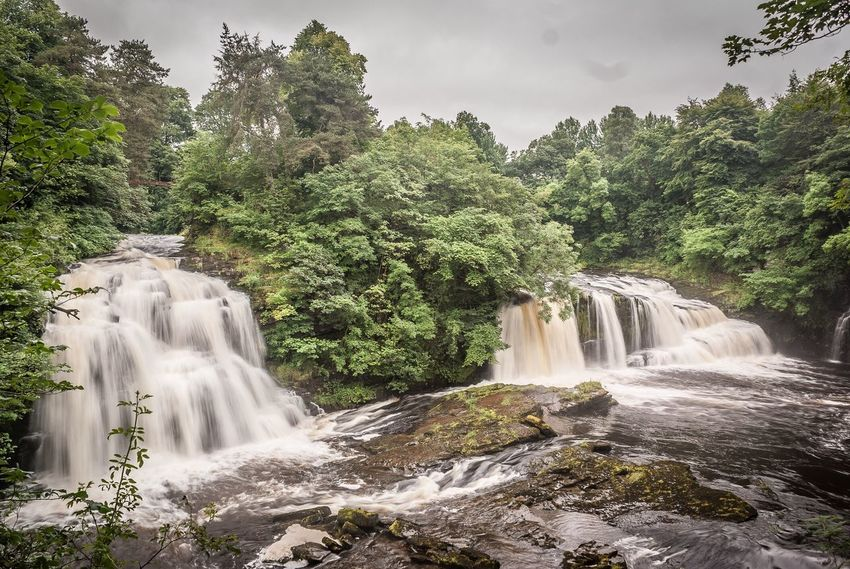 New Lanark Waterfall Tree Water Scenics Motion Nature Beauty In Nature No People Landscape Long Exposure Day Growth Outdoors Sky Eyeem Scotland  Scotland's Scenery