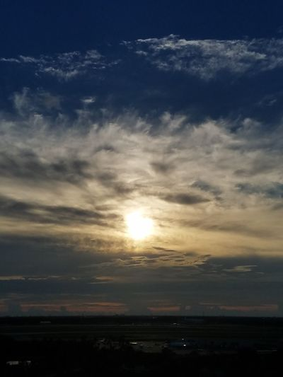 Chemtrail Sunset Sunset Chemtrails Sky Dramatic Sky Cloudscape ScenicsSunlight Outdoors No People Nature Dusk Awe Tranquility Landscape Business Finance And Industry Sun City Beauty Beauty In Nature Blue