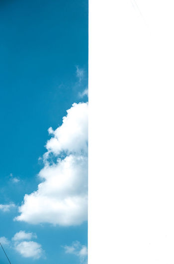 Blue Sky & White Wall Beauty In Nature Blue Cloud - Sky Day Low Angle View Nature No People Outdoors Sky