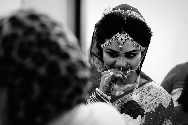 Smiling beautiful bride in wedding ceremony