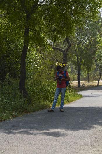 Full length of man walking on road