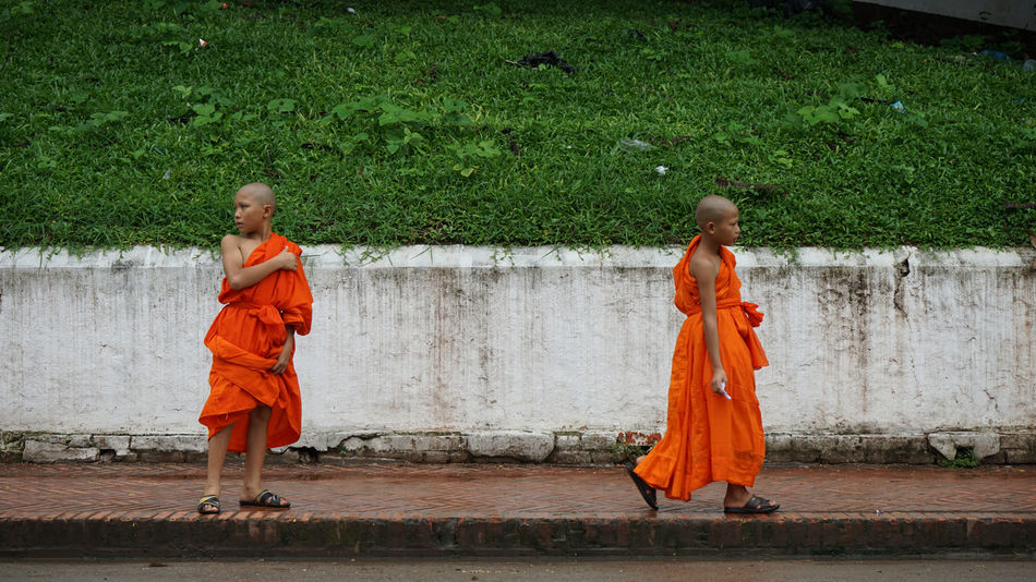 Traditional Clothing Full Length Real People Two People Rear View Togetherness Day Men Outdoors Women Adult Water Bonding Only Women Adults Only Friendship People Young Adult Monks Monks Walking Young Monk