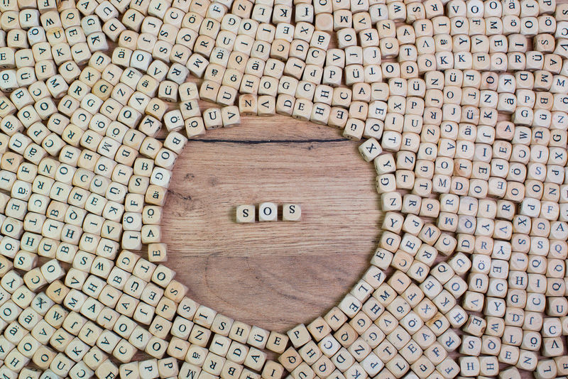 SOS, German text for distress signal, word in letters on cube dices on table Cube Letters Text Wooden Table Word Concept Distress Distress Signal Emergency Telephone Flat Lay Help Keyword Label Macro Morse Code Rescue Ship Radio Siren Sos