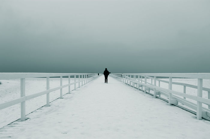 It was calm, cool day and so great contrasts between gray and white Cold Temperature Day Desaturated Diminishing Perspective Full Length Ice Jetty One Man Only One Person Outdoors Sky Snow Tranquility Viewpoint Winter